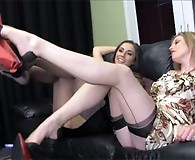 Paige peels off this lesbians nylons and kisses her feet as she rubs her wet pussy slowly.