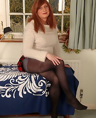 Luci May's fuzzy jumper should only be worn with tiny little skirts and opaque pantyhose, then she will be turned on enough to play