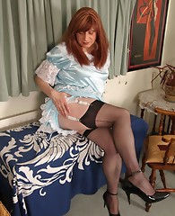 Kinky Maid Luci May rewards herself after a hard day cleaning and dusting, with a nice wank leant against her masters table