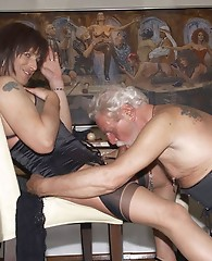 Sexy TGirl slut gets shared around at a fetish party.