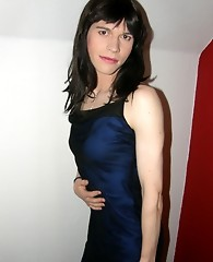 Crossdresser wearing a sultry blue dress and posing