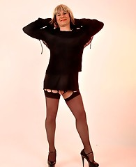 This fun loving crossdresser loves having her nylon covered legs licked