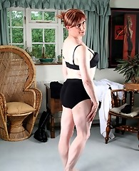 Fetish queen Lucimay wearing a saucy petticoat and garter set