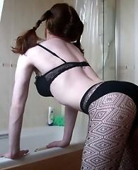 Horny crossdresser performs a naughty strip tease