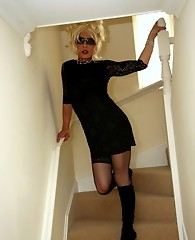 Zoe looking like a movie star in her blonde wig and tight black dress masturbating