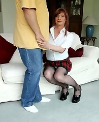 Crossdressing Lucimay wearing a tiny mini skirt and sucking cock