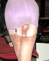 This crossdressing tart lovees her nylon stockings and suspenders