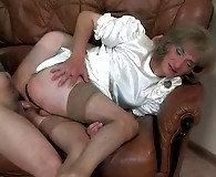 Dolled-up sissy guy in a striking white satin dress ready to be ass robbed