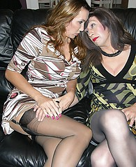 Kinky brunette TGirl has fun licking hot Milf's sexy nylon legs and ass
