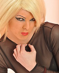 Jodie is one petite and sexy first time TGirl and her cute look will take your breath away! Under that gorgeous blonde hair of hers lies a sultry look