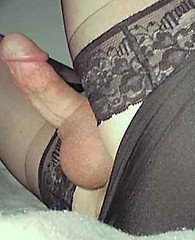 Nylon loving crossdressers showing off their very hard cocks